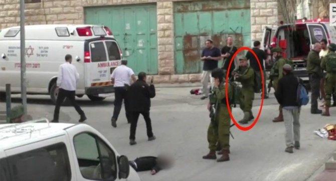 israil-askeri-onlarca-kisinin-gozleri-onunde-yarali-filistinliyi-vurdu.jpg
